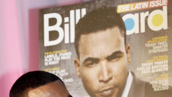 Puerto Rican reggaeton singer-rapper Don Omar smiles as he talks to a reporter in Miami, Tuesday, April 24, 2012. Don Omar is the is the leading finalist in the 2012 Billboard Latin Music Awards. (AP Photo/Alan Diaz)