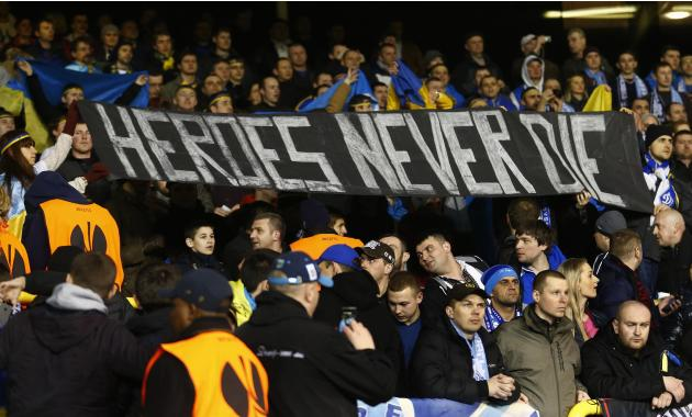 Dnipro supporters hold up a banner before their Europa League soccer match against Tottenham Hotspur at White Hart Lane in London