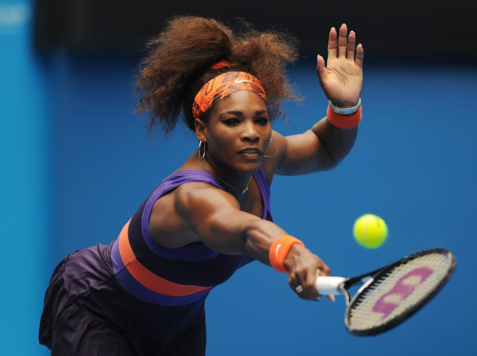 Serena Williams of the US hits a backhand return to Spain's Garbine Muguruza during their second round match at the Australian Open tennis championship in Melbourne, Australia, Thursday, Jan. 17, 2013. (AP Photo/Andrew Brownbill)