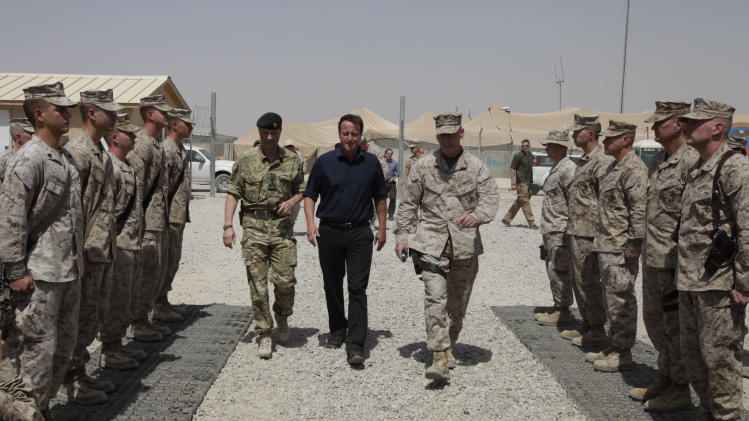 Britain's Prime Minister David Cameron, center, arrives to deliver a speech to British and US troops during a visit at Camp Bastion, outside Lashkar Gah, the provincial capital of Helmand province in south Afghanistan, Monday, July 4, 2011. (AP Photo/Lefteris Pitarakis, pool)