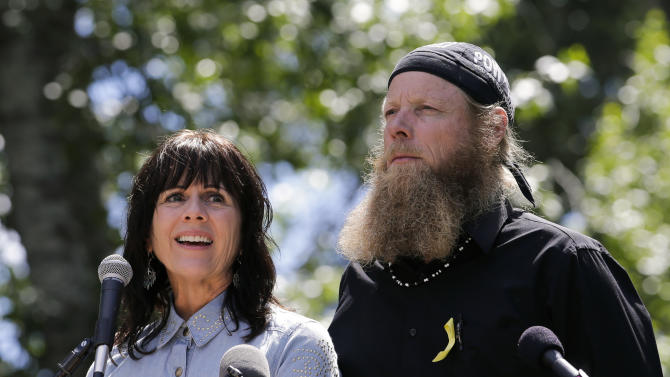 """Jani Bergdahl, left, joined by husband, Bob, the parents of captive U.S. Army Sgt. Bowe Bergdahl, speaks at the """"Bring Bowe Back"""" celebration held to honor Sgt. Bergdahl in Hailey, Idaho, Saturday, June 22, 2013. Hundreds of activists for missing service members gathered in a small Idaho town Saturday to hear the parents of the only known U.S. prisoner of war speak just days after his Taliban captors announced they want to exchange him for prisoners being held at Guantanamo Bay. (AP Photo/Jae C. Hong)"""