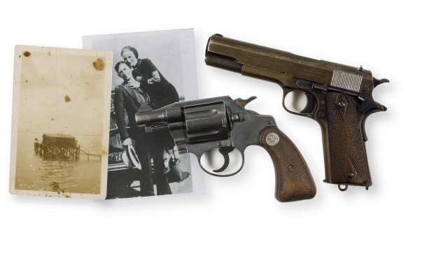 Two pistols, shown in this RR Auction photograph, found on the bodies of famed Depression-era outlaws Bonnie Parker and Clyde Barrow after they were killed by a posse in 1934 have sold at auction for a total of $504,000at an auction in Nashua, New Hampshire on September 30, 2012.    REUTERS/RR Auction/Handout  (UNITED STATES - Tags: CRIME LAW SOCIETY) NO SALES. NO ARCHIVES. FOR EDITORIAL USE ONLY. NOT FOR SALE FOR MARKETING OR ADVERTISING CAMPAIGNS. THIS IMAGE HAS BEEN SUPPLIED BY A THIRD PARTY. IT IS DISTRIBUTED, EXACTLY AS RECEIVED BY REUTERS, AS A SERVICE TO CLIENTS