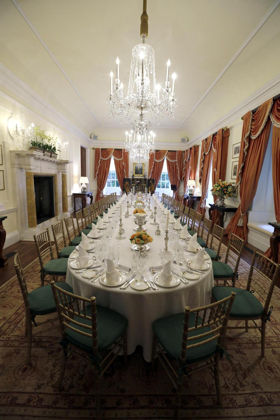 The place settings are set for dinner for 37 people for England's Prince Harry, at the British Ambassador's residence, Thursday, May 9, 2013 in Washington. (AP Photo/Alex Brandon, Pool)