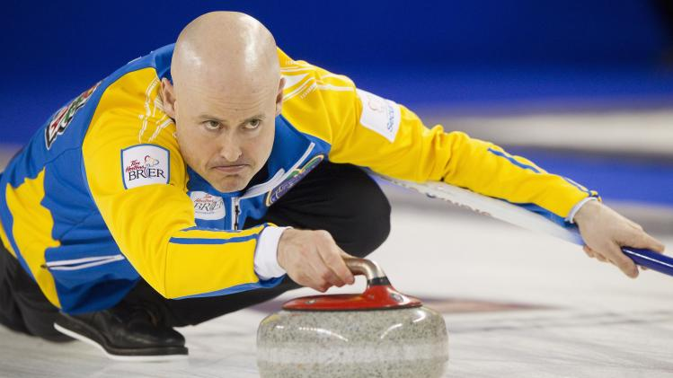 Team Alberta skip Kevin Koe delivers a stone against team British Columbia in the 1st end during their draw at the 2014 Tim Hortons Brier curling championships in Kamloops