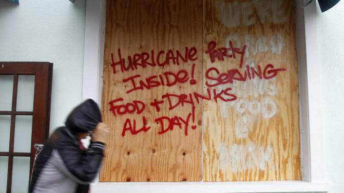 A person walks by a sign warning about Hurricane Isaac, in Key West, Fla., Sunday, Aug. 26, 2012. Isaac gained fresh muscle Sunday as it bore down on the Florida Keys, with forecasters warning it could grow into a dangerous Category 2 hurricane as it nears the northern Gulf Coast. (AP Photo/Alan Diaz)