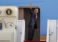 President Barack Obama waves as he boards from Air Force One before departing at Andrews Air Force Base, Md., Wednesday, Sept. 5, 2012, en route to Charlotte, N.C. for the Democratic National Convention. ( AP Photo/Jose Luis Magana)