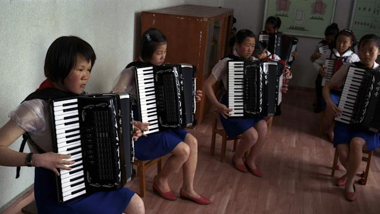 In this April 3, 2012 photo, North Korean students practice playing the accordions at the Samjiyon Schoolchildrens' Palace in Samjiyon, North Korea. The facility was built for children to take part in after school programs in the arts, sciences, sports, computer and vocational training. (AP Photo/David Guttenfelder)