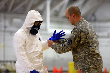 U.S. Army soldiers from the 101st Airborne Division, who are earmarked for the fight against Ebola, train before their deployment to West Africa, at...