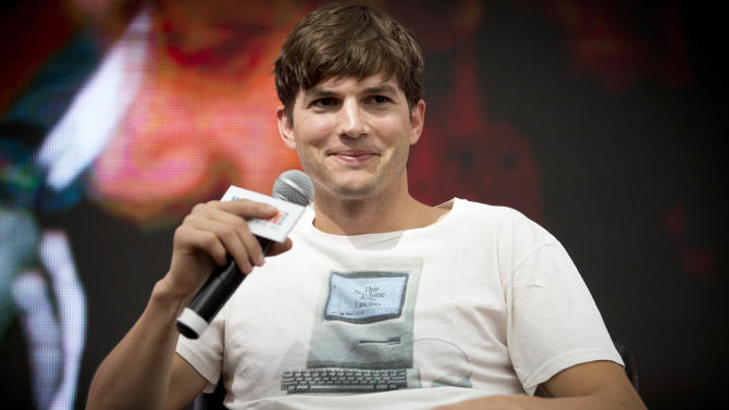 """FILE - In this Sunday, Aug. 25, 2013, file photo, American actor Ashton Kutcher, who portrays Apple's Steve Jobs in the film """"Jobs"""" smiles at a promotional event hosted by the Macworld iWorld expo in Beijing, China. Computer-maker Lenovo annoucned Wednesday, Oct. 30, 2013, it has hired tech-savvy actor Ashton Kutcher to help design and pitch its latest line of tablets, dubbing the Hollywood star a """"product engineer"""" who can bring his ideas along with his image. (AP Photo/Andy Wong, File)"""