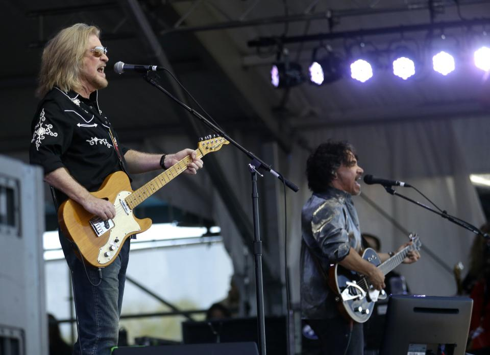 Daryl Hall, left, and John Oates perform at the New Orleans Jazz and Heritage Festival in New Orleans, Sunday, May 5, 2013. (AP Photo/Gerald Herbert)