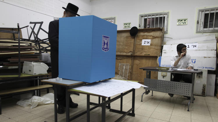 Ultra-orthodox Jew votes in Bnie Brak, Israel, during legislative elections Tuesday, Jan. 22, 2013.  Israelis began trickling into polling stations Tuesday morning to cast their votes in a parliamentary election expected to return Prime Minister Benjamin Netanyahu to office despite years of stalled peacemaking with the Palestinians and mounting economic troubles. Polls indicate about a dozen of 32 parties competing in Tuesday's election have a chance of winning seats in the 120-member parliament. Most parties fall either into the right-wing-religious or center-left camp, and surveys indicate hard-line and ultra-Orthodox Jewish parties will command a majority. (AP Photo/Oded Balilty)