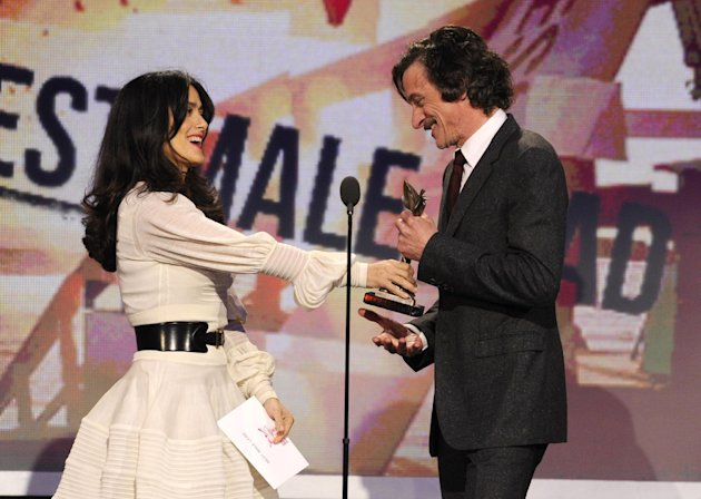 "Actress Salma Hayek, left, presents John Hawkes with the award for best male lead for ""The Sessions"" at the Independent Spirit Awards on Saturday, Feb. 23, 2013, in Santa Monica, Calif. (Photo by Chris Pizzello/Invision/AP)"