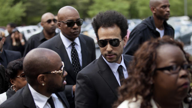 Rapper-producer Jermaine Dupri, left, and Chris Smith, center, of the rap duo Kris Kross, arrive for the funeral service of Kriss Kross band member Chris Kelly, along with manager Michael Mauldin, rear, Thursday, May 9, 2013, in Atlanta. The 34-year-old Kelly was found dead May 1 of a suspected drug overdose. Kriss Kross, the rap duo of Kelly and  Smith, was introduced to the music world in 1992 by music producer and rapper Jermaine Dupri after he discovered the pair at a mall in southwest Atlanta. (AP Photo/David Goldman)