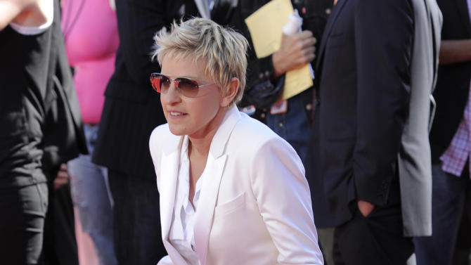 """In this May 26, 2010 photo, Ellen DeGeneres arrives at the """"American Idol"""" finale in Los Angeles. DeGeneres served as an """"American Idol"""" judge during the 2010 season. Randy Jackson, Paula Abdul and Simon Cowell were the original judges on """"American Idol."""" The cast of judges has changed over the years, with Jackson now the lone judge left from the first season. On Sunday, Sept. 16, 2012, singer-rapper Nicki Minaj and country crooner Keith Urban were named as judges, joining Mariah Carey and Jackson, as the judges' panel has now expanded to four members from its previous three. (AP Photo/Chris Pizzello)"""