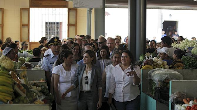 Spain's Queen Letizia visits the central market of the town of Suchitoto with congresswoman Jakeline Rivera and mayor Pedrina Rivera during an official visit to El Salvador