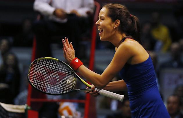 Serbian Ana Ivanovic reacts after scoring a point against Russian Maria Sharapova during an exhibition game in Bogota, Colombia, Friday, Dec. 6, 2013