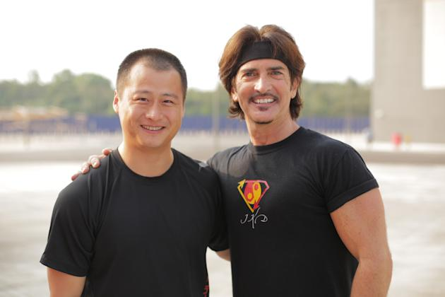 "In this photo taken on Friday, March 7, 2014, provided by Brian Ho, stunt man Ju Kun, left, poses with John Fusco, creator of the show ""Marco Polo"" on the back lot of the new Pinewood Studio"