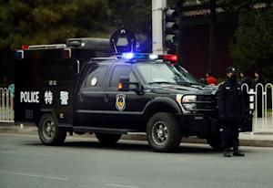Chinese police monitor the access roads leading to…