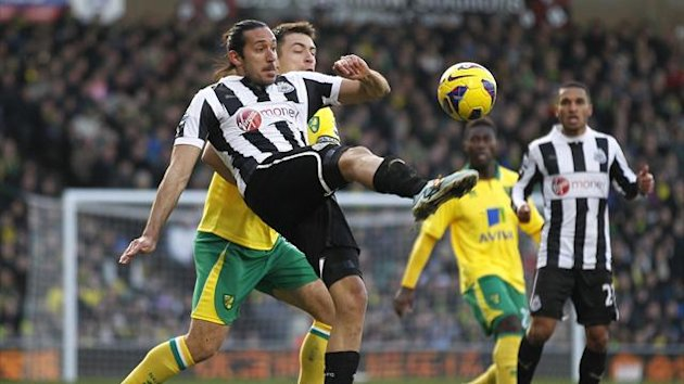Newcastle United's Argentinian midfielder Jonas Gutierrez (L) vies with Norwich City's Scottish defender Russell Martin during an English Premier League football match between Norwich City and Newcastle United at Carrow Road in Norwich, England (AFP)