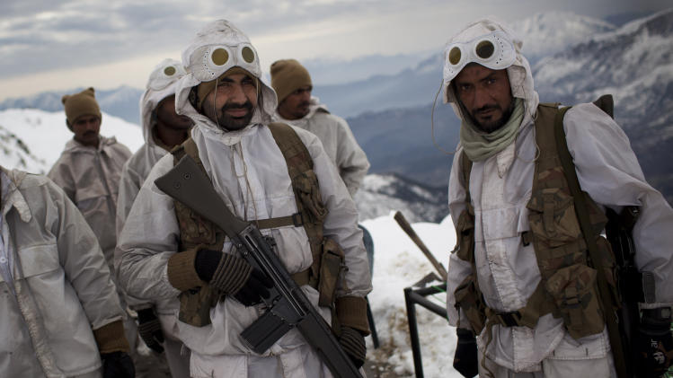 In this Sunday, Feb. 19, 2012, photo, Pakistani Army soldiers with the 20th Lancers Armored Regiment prepare for a patrol atop the 8000 foot mountain near their outpost at Kalpani Base in Pakistan's Dir province on the Pakistan-Afghan border. Five years after setting up an umbrella organization to unite a violent symphony of militant groups operating in Pakistan's tribal regions, the Pakistani Taliban is fractured, strapped for cash and losing the support of a local population that is frustrated by a protracted war that has forced thousands out of their homes, say analysts and residents of the area. (AP Photo/Anja Niedringhaus)