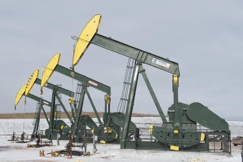 Oil turns higher as Wall Street rally offsets inventory rise