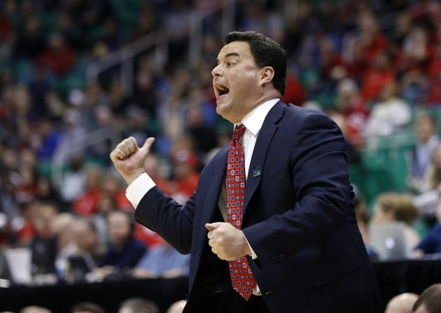 Arizona head coach Sean Miller directs his team during the first half of their second round NCAA tournament basketball game against Belmont in Salt Lake City, Utah