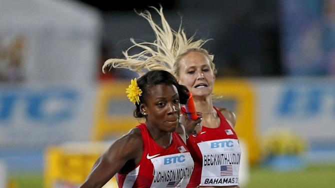 Molly Beckwith-Ludlow of the U.S. passes the baton to Alysia Montano for the anchor leg during the U.S. women's win in the 4x800 relay race at the IAAF World Relays Championships in Nassau
