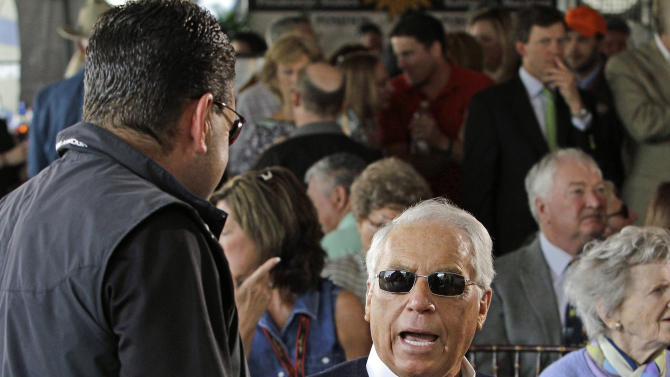 Hall of Fame trainer D. Wayne Lukas talks with Jim Barnes from the Bob Baffert stables during the Preakness Stakes post position draw at Pimlico Race Course in Baltimore, Wednesday, May 15, 2013. Lukas will send three horses to the gate in Saturday's Preakness Stakes horse race. (AP Photo/Garry Jones)