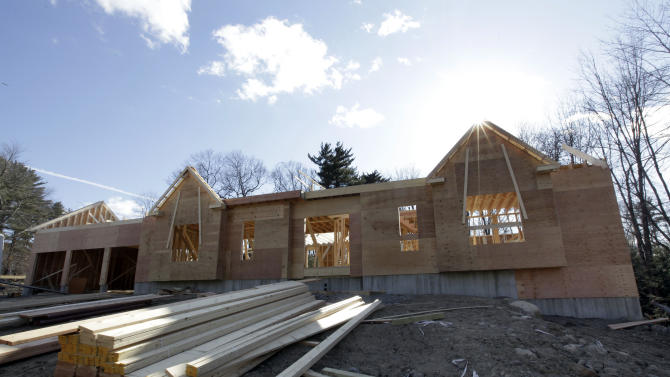 In this Feb. 13, 2012 photo, a new single-family house goes up in North Andover, Mass. Construction of single-family homes in the U.S. cooled off slightly in January after surging in the final month last year. But a rebound in volatile apartment construction kept builders working. (AP Photo/Elise Amendola)