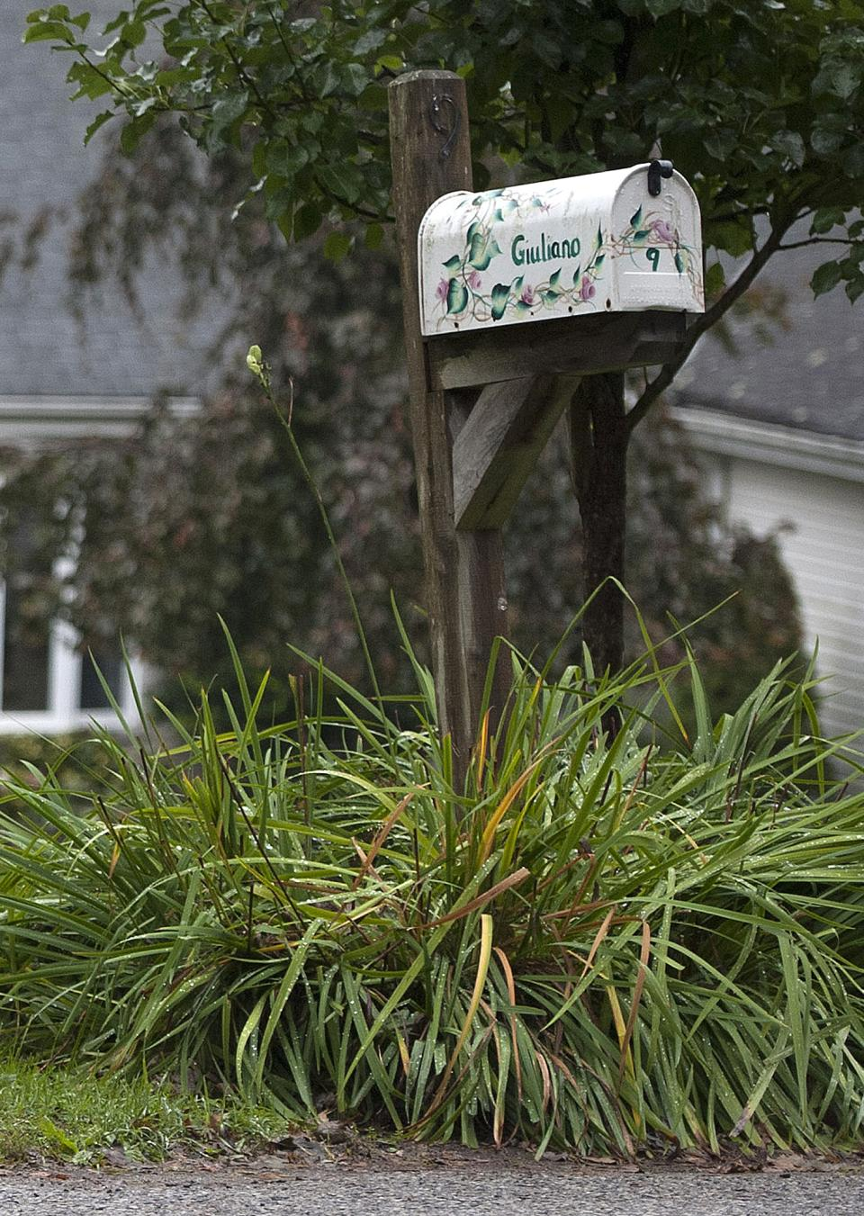 A mailbox sits in front of the home of Jeffrey Giuliano in New Fairfield, Conn., Friday, Sept. 28, 2012. Giuliano fatally shot a masked teenager in self-defense during what appeared to be an attempted burglary early Thursday morning, then discovered that he had killed his son, state police said. (AP Photo/Jessica Hill)