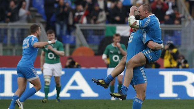 Italy's Sergio Parisse (R) celebrates with teammate Alessandro Zanni (L) after winning against Ireland at the end of their Six Nations international rugby union match at the Olympic Stadium in Rome March 16, 2013 (Reuters)