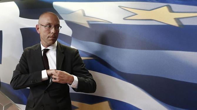 European Central Bank (ECB) executive board member Joerg Asmussen leaves a podium after a news conference in Athens