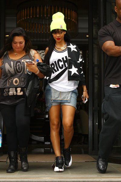 This look is so bad it's good; Rihanna does the unthinkable and wears a pair of short overalls in public with a tank and jacket, and somehow, the addition of a neon knit hat and Air Jordans ties it to
