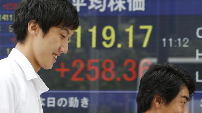 People walk by an electronic stock board of a securities firm in Tokyo as Japan's bench mark Nikkei 225 index shows 258.36 points gain to 14,119.17 Monday morning, Sept. 9, 2013. Asian stocks opened higher on Monday, lifted by Tokyo's Olympic bid victory, Chinese export growth and an Australian conservative coalition's election victory. (AP Photo/Koji Sasahara)