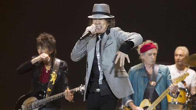 CORRECTS REFERENCE TO NUMBER OF SHOWS - Mick Jagger, center, Keith Richards, Ronnie Wood, left, and Charlie Watts, right, of The Rolling Stones perform at the O2 arena in east London, Sunday, Nov. 25, 2012. The band are playing five shows to celebrate their 50th anniversary, including two shows at London's O2 and three more in New York. (Photo by Joel Ryan/Invision/AP)
