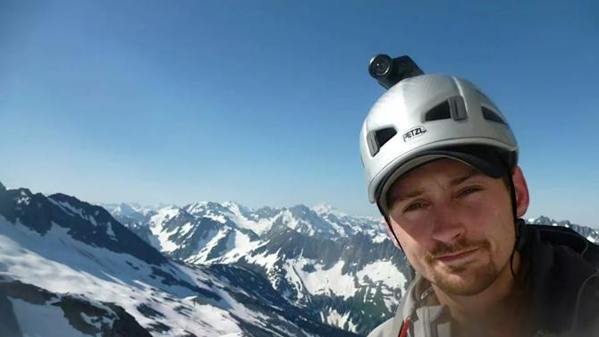 In this undated family photo Mark Mahaney poses for a photo at Mount Rainier National Park in Washington state. Mahaney is one of six climbers who likely plummeted to their deaths off Mount Rainier in Washington state in May 2014. (AP Photo/Mahaney Family)