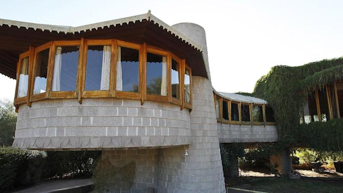 This Oct. 19, 2012 photo shows the home designed by noted architect Frank Lloyd Wright which had been threatened with demolition in Phoenix. An anonymous benefactor has purchased and wants to preserve a Frank Lloyd Wright-designed home in Phoenix that had been threatened with demotion. That's according to a real estate broker, city officials and a group that champions preservation of structures design by Wright. (AP Photo/Ross D. Franklin)