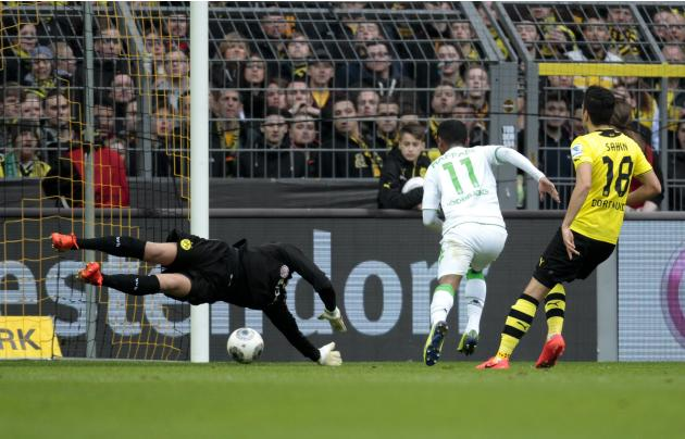 Borussia Moenchengladbach's Raffael scores a goal against Borussia Dortmund during the German first division Bundesliga soccer match in Dortmund