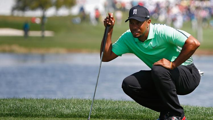 Tiger Woods lines up a shot during the second round of The Honda Classic at PGA National Resort and Spa on February 28, 2014 in Palm Beach Gardens, Florida