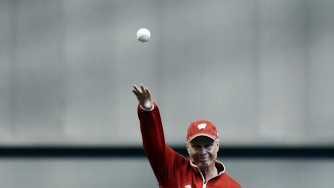 Wisconsin basketball coach Bo Ryan throws out a ceremonial first pitch beforenma baseball game between the Milwaukee Brewers and the Los Angeles Dodgers Monday, May 4, 2015, in Milwaukee. (AP Photo/Morry Gash)