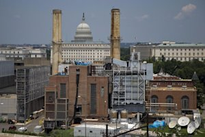 The Capitol Dome is seen behind the Capitol Power Plant …