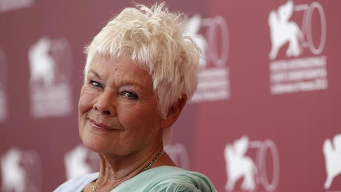 FILE - In this Saturday, Aug. 31, 2013 file photo, Judi Dench poses for photographers during a photo call to promote the film Philomena at the 70th edition of the Venice Film Festival, Italy. Stars including Judi Dench, Chiwetel Ejiofor, and pop singer Nicole Scherzinger are due on the red carpet at London's Royal Opera House for the Olivier theater awards on Sunday April 12, 2015.  (AP Photo/David Azia, File)