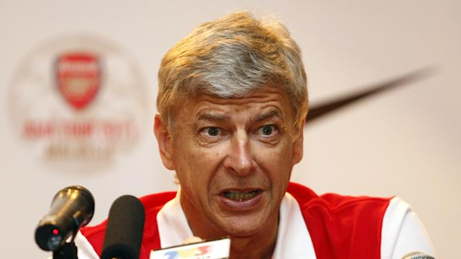 Arsenal manager Arsene Wenger speaks during a press conference at a hotel in Kuala Lumpur, Malaysia, Monday, July 11, 2011. Arsenal Football Club will play with the Malaysia XI, a Malaysia League selection, in their friendly soccer match on Wednesday, July 13. (AP Photo/Lai Seng Sin)
