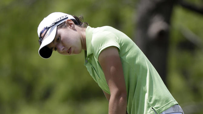 Carlota Ciganda, of Spain, putts on the first hole during the final round of the North Texas LPGA Shootout golf tournament on Sunday, April 28, 2013, at Los Colinas Country Club in Irving, Texas. (AP Photo/LM Otero)