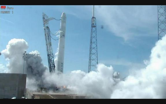 SpaceX Test Fires Private Rocket Bound for Space Station