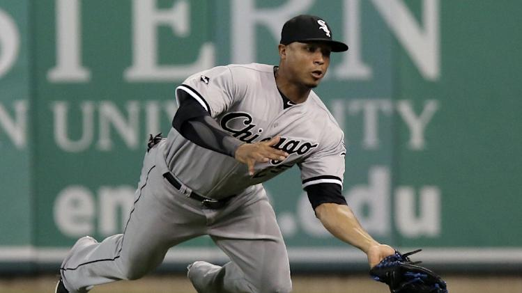 Chicago White Sox's Moises Sierra makes a diving catch of a fly ball hit by Detroit Tigers' Rajai Davis during the ninth inning of a baseball game Tuesday, July 29, 2014, in Detroit. (AP Photo/Duane Burleson)