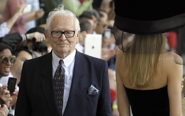 French fashion designer Pierre Cardin appears at the end of his Men's Spring-Summer 2013 collection, for the Paris Fashion Week, in Paris, France, Sunday, July 1, 2012. (AP Photo/Francois Mori)
