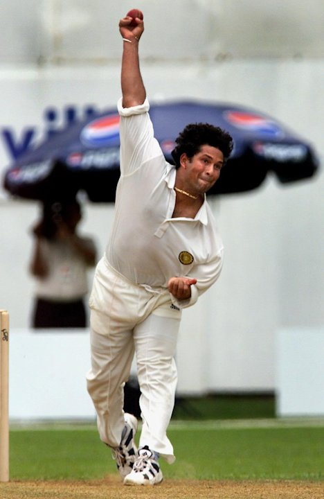 (FILES) This September 9, 1999 file photograph shows Indian cricketer Sachin Tendulkar as hebowls a ball to an Antiguan batsman as Antigua struggles to 164 from their 41 overs at the XVI Commonweath G
