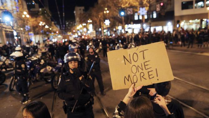 A protester holds up a sign during a demonstration against the grand jury decision in the Ferguson, Missouri shooting of Michael Brown in San Francisco, California