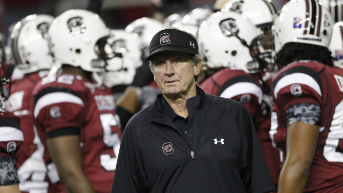 FILE - In this file photo taken Dec. 4, 2010, South Carolina coach Steve Spurrier watches his team prior to the Southeastern Conference Championship NCAA college football game against Auburn in Atlanta. Spurrier has a plan to pay players, and it wouldn't cost schools or conferences a dime. He offered an interesting yet far-from-feasible proposal Wednesday, June 1, 2011, that would give 70 players $300 every game for expenses. (AP Photo/John Bazemore, File)